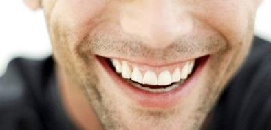 man-smiling-in-black-shirt.jpg